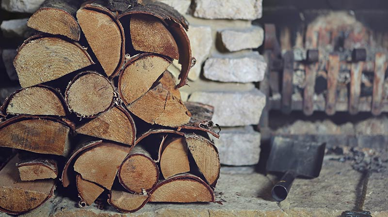 Firewood stacked by fireplace